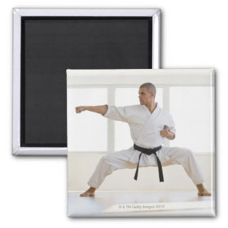 Hispanic male karate black belt in fighting magnet