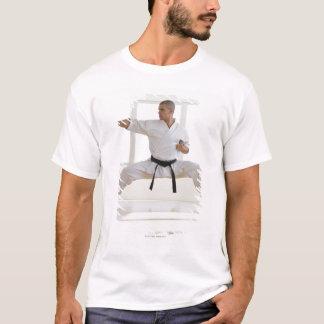 Hispanic male karate black belt in fighting T-Shirt