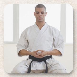 Hispanic male karate black belt meditating coaster