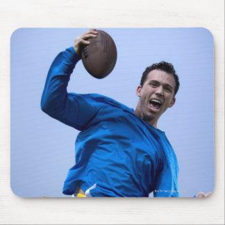 Hispanic man throwing a football mouse mat