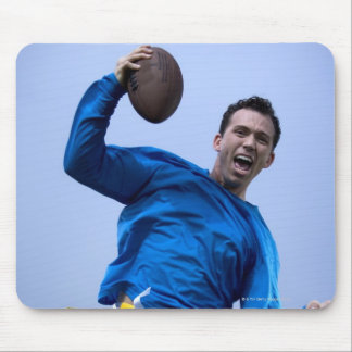 Hispanic man throwing a football mouse pad