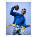 Hispanic man throwing a football post cards
