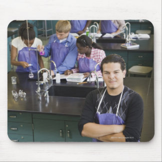 Hispanic student standing in chemistry lab mouse mat