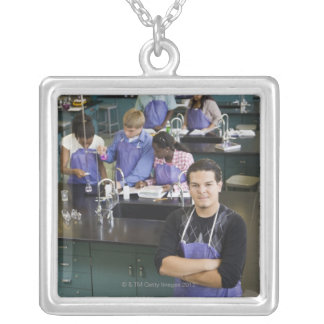 Hispanic student standing in chemistry lab silver plated necklace