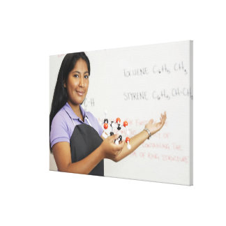 Hispanic teenaged girl in science class gallery wrapped canvas