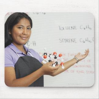 Hispanic teenaged girl in science class mouse pads
