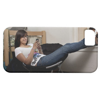 Hispanic woman hanging out in college dorm room iPhone 5 covers