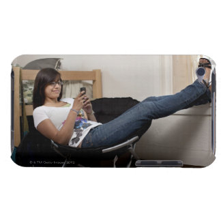 Hispanic woman hanging out in college dorm room iPod Case-Mate case