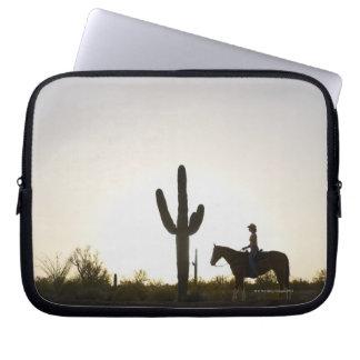 Hispanic woman riding horse laptop sleeve
