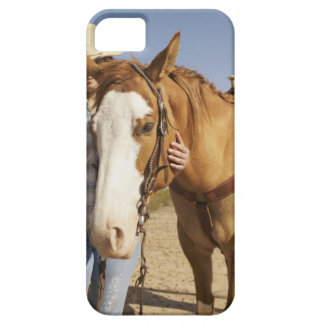 Hispanic woman standing next to horse iPhone 5 cases