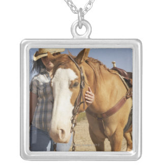 Hispanic woman standing next to horse silver plated necklace