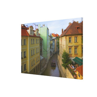 Historical buildings with canal, Prague, Czech Canvas Print