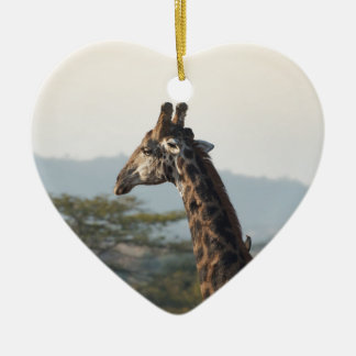 Hitching a ride on a giraffe ceramic heart decoration