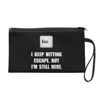 Hitting Escape Key Wristlet Purses