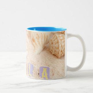 Hola hello in Spanish on a sandy beach Mugs