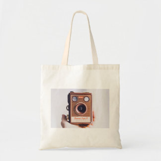 holding retro old manual camera budget tote bag
