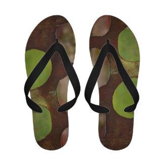 Holes In Metal Sandals