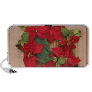 Holiday wreath on door travel speakers
