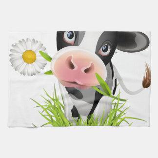 Holstein cow in grass tea towel