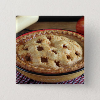 Home baked apple pie on cooling rack with apple 15 cm square badge