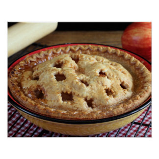 Home baked apple pie on cooling rack with apple poster