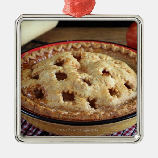 Home baked apple pie on cooling rack with apple silver for Apple pie decoration