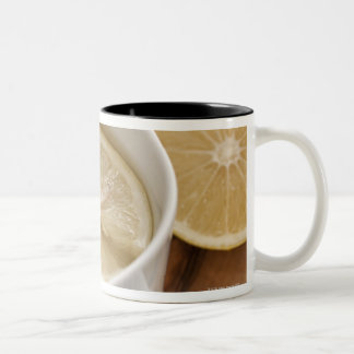 home made cold and flu remedy; lemons and honey coffee mugs