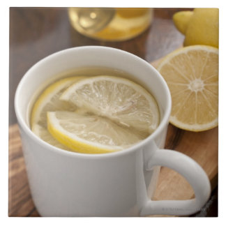 home made cold and flu remedy; lemons and honey large square tile