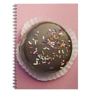 Homemade chocolate dessert with sprinkles notebooks