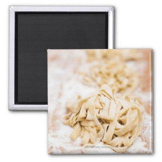 Homemade ribbon pasta close up fridge magnet