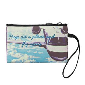 Hop on a plane coin purses