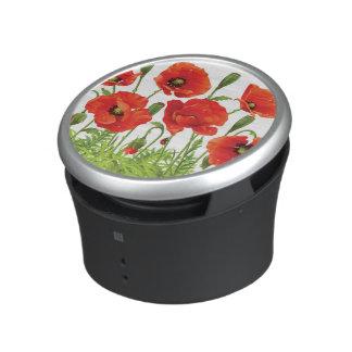 Horizontal border with red poppy bluetooth speaker