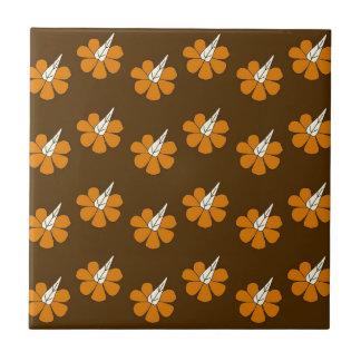 Hornflower on brown tile