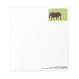 Horse grazing on green background notepad