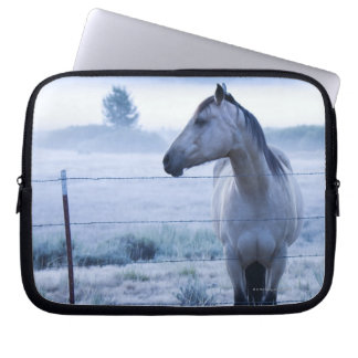 Horse in hazy field laptop sleeve