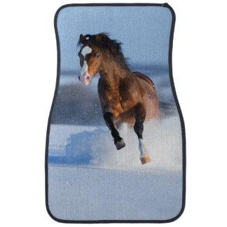 Horse running across the field in winter car mat
