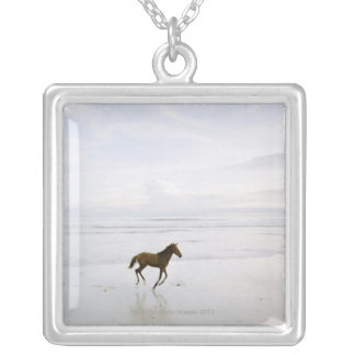 Horse running on the beach silver plated necklace