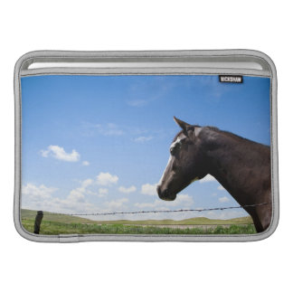 Horse standing at fence in pasture MacBook air sleeve