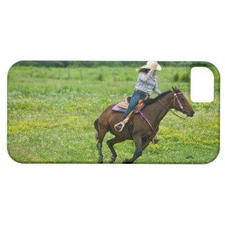 Horseback rider galloping in rural pasture iPhone 5 cover