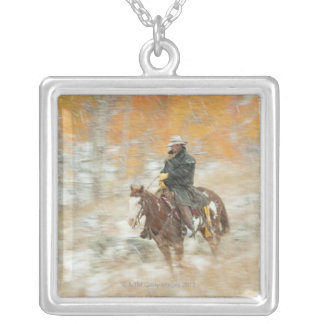 Horseback rider in rain silver plated necklace
