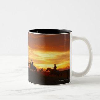 Horseback riders at sunset Two-Tone mug