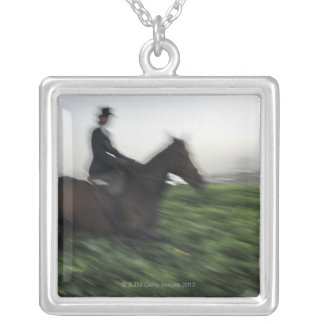 Horseback riding in green field. Woman horseback Silver Plated Necklace