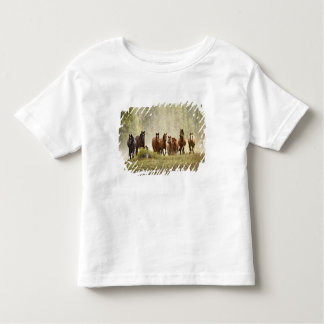 Horses cresting small hill during roundup, toddler T-Shirt