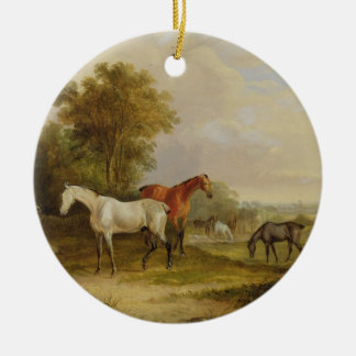 Horses Grazing: A Grey Stallion grazing with Mares Round Ceramic Decoration