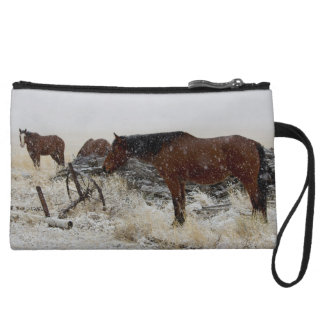 Horses on A Snowy Day - by old cart and fence post Wristlet Clutch