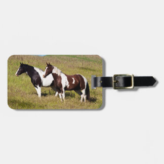 Horses on the hillside luggage tag