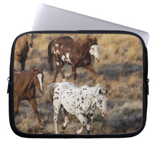 Horses roaming the scenic hills of the Big Horn Laptop Sleeve