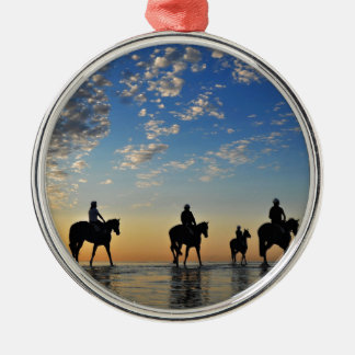 horses with riders walking on the sea at sunset christmas ornament