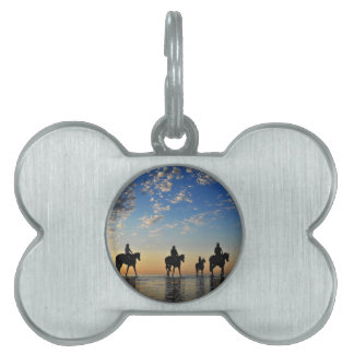horses with riders walking on the sea at sunset pet name tag