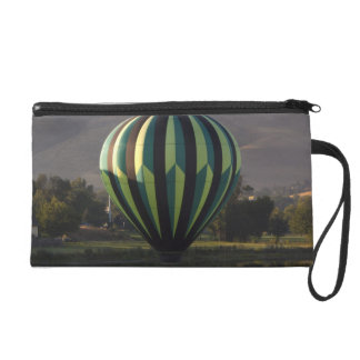 Hot air balloon over the Yakima River 2 Wristlet